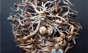 Escultura de madeira do Homem e da Natureza